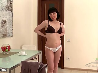 Cherry Despina plays with her hairy pussy