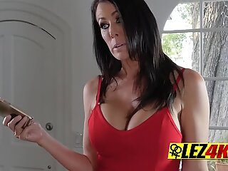 Busty lesbian makes younger chick get naked and use her tongue