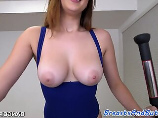 Busty amateur gags on an enormous cock